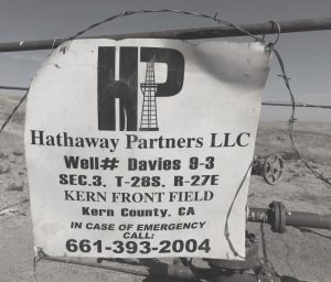 Hathaway oil sign in black and white